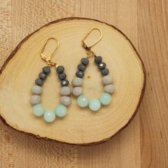 New for Spring 2015 Blue jade and glass crystal teardrop earring. Ear wire: – Gold plate over brass – Leverback – Lead & nickel free, hypoallergenic Handmade in Portland, Oregon.