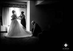 Jack and Rachael's Normandy Farm Wedding in Blue Bell  Maid of Honor and Bridesmaid helping the bride while she waits for her dad to see her for the first time on her wedding day at #normandyfarm venue.  #blackandwhite #bride #weddingideas #joedantonephotography