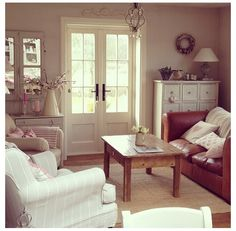 leather sofa, cute slipcover, perfect french door  . . .   sweet room
