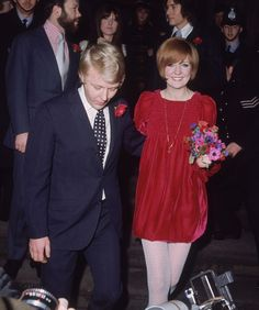 Cilla Black and Bobby Willis, 1969 / Hey, if you want to wear a red velvet babydoll dress (by designer John Bates) to get married, like British singer Cilla Black did, I'm not going to stop you.