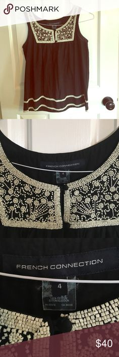 Beautiful Beaded Boho Tank by French Connection 100% cotton, perfect for summer! Loose fitting, charcoal gray top with gorgeous beadwork designs on front, back, and along the bottom of shirt. Excellent condition. Tops