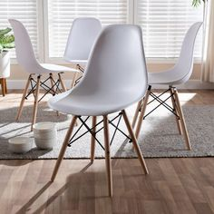Baxton Studio Sydnea Mid-Century Modern White Acrylic Brown Wood Finished Dining Chair (Set of - Sydnea dining chair combines practicality and comfort in an iconic look. The white acrylic seat and chair back are formed to contour the se Acrylic Dining Chairs, Mismatched Dining Chairs, White Dining Chairs, Dining Chair Set, Dining Room, Accent Chairs, Dining Tables, Mid Century Dining, Cafe Chairs