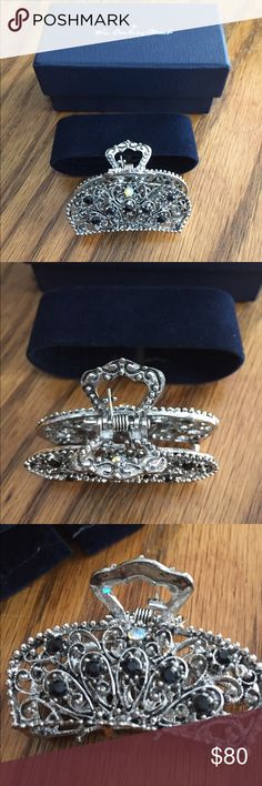 New Danbury Mint Silver Hair Clip with jewels New in original box. Was my grandmothers    It's about 2 inches long. With black jewels and one shiny opalish  pink.        Silver- not sure of exact materials and jewels.  Looked online at web site. But no longer made Danbury Mint Accessories Hair Accessories