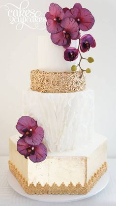 Gold and cream wedding cake with purple orchids   Sequin Wedding Cakes with metallic gold and silver accents via @BelleMagazine