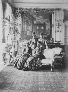 Louise, Queen of Denmark (1817-98) and her three daughters. Seated next to the Queen is Thyra, Duchess of Cumberland (1853-1933). Behind them stand the Princess of Wales (1844-1925), later Queen Alexandra and Maria Feodorovna (1847-1928), Empress of Russia