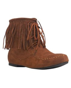 "Inspired by beautiful Native American fashion, this moccasin style low top shoe has a flat TPR sole and low boot heel topped with a faux suede upper that has moccasin stitching along the toe cap, fringe around the cuff, and a lace up construction. Shaft measures 6.5"".      Man Made Materials     Imported"