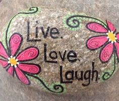 Hand-painted, one-of-a-kind Happy Rock - Live. - surrounded by pink flowers. This beautiful one-of-a-kind river rock was found on the banks of the Brewster River in Jeffersonville, VT. Not that you need a use for a Happy Rock, but there are m Pebble Painting, Pebble Art, Stone Painting, Diy Painting, Painting Flowers, Rock Painting Patterns, Rock Painting Ideas Easy, Rock Painting Designs, Happy Rock