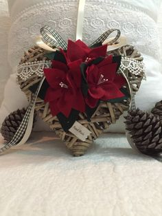Wicker heart with ornaments in pannolenci by cosediluna on Etsy https://www.etsy.com/listing/249225649/wicker-heart-with-ornaments-in