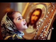 A girl at church on Palm Sunday in Russia.
