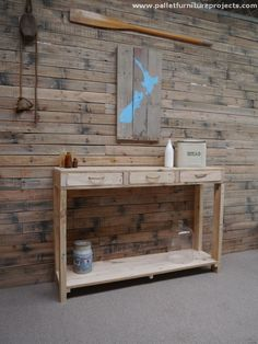 Here comes another classic wooden pallet recycled hallway table. This time we made it a bit typical by installing some built in drawers. Plus it is provided with ample storage space right below the drawers. We kept it unstained to maintain its rustic and natural look.