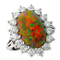 10 Carat Black Opal Diamond Platinum Ring | From a unique collection of vintage more rings at https://www.1stdibs.com/jewelry/rings/more-rings/
