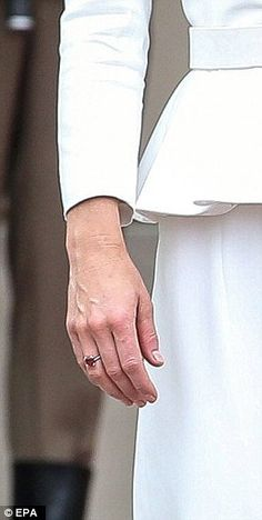 The Duchess showed off a new red ring on her right hand...