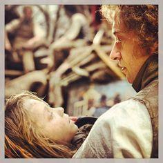 Les Mis (2012)   Daniel Huttlestone (Gavroche) in Hugh Jackman's (Valjean) arms in the big screen adaptation of Les Misérables.