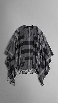 I'd wear this over everything...    Burberry, $550