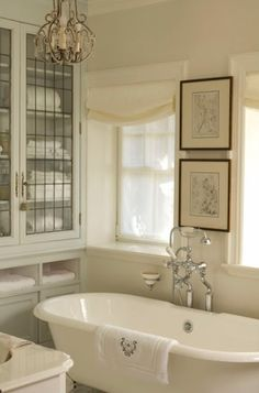 Vintage fixtures and a roll-top pedestal bath tub set the traditional tone of this soothing and elegant principal bathroom. ~built-in by chelseaAEO