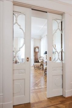 Inspiration for Den/Office pocket doors. Could be frosted glass or other to obscure view but let in light.