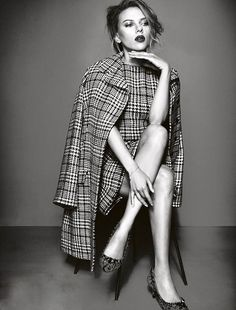 Scarlett Johansson looking sophisticated and ladylike in a plaid dress and matching cape,