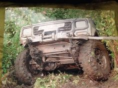Me in the old Daihatsu winching up out of a river