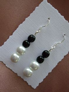 Sterling Silver Earrings with white glass pearls and pressed black jet beads