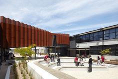 """Completed in 2015 in Braybrook, Australia. Images by Peter Clarke. The """"Flyover Gallery"""" as it is now named, was and still is an existing first floor pedestrian [student & staff] link way between two precincts..."""