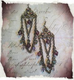 May challenge chandelier earrings using a brass ox filigree that I cut in half  I then add the rose montees from B'sue Boutiques and bits and bob from my stash.