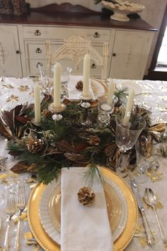 A simple centerpiece, crystal candle sticks and even a wine glass....Christmas in the Country: table settings