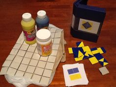 IQ Blocks, a homemade game for Visual Spatial Reasoning inspired by  http://learnersinbloom.blogspot.com/2012/11/iq-blocks-another-homemade-game-for.html    PDF of tiles here http://www.testingmom.com/wp-content/uploads/PatternBlocks-2.pdf (cut up after printing 6 to a page.     I used leftover bathroom tiles, several coats of paint and two coats of Mod Podge.  I store the tiles in a VHS tape box, which has the bonus a plastic holder to display the tile pattern.  Similar to tangrams