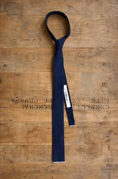 Hmmm we may need to try this - skinny navy tie. Flat cut bottom
