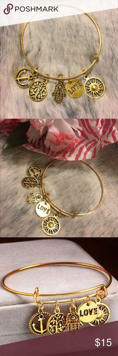 GOLD WIRE BANGLE CHARM BRACELET Gold tone wire bangle charm bracelet. It has 5 charms, an anchor, tree of life, hamsa, love text and a sun. DYOSARA Jewelry Bracelets