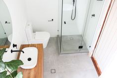 Brick Bond Subway, Brick Stack Bond Tiling, Frameless Shower Screen, Real Timber Vanity, Matte Black Tapware, Rounded Mirror, Matte White Tiles, Back To Wall Toilet, Freestanding Bath, Concrete Freestanding Bath, Grey and White Bathrooms, OTB Bathrooms