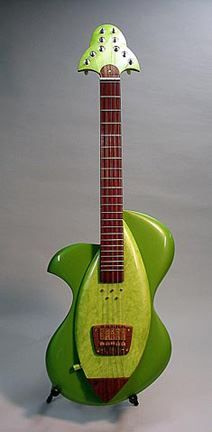 """Electric guitars by Peter Malinoski. As Peter says: """" The look of my guitars are different from anything else while still in touch with the shapes and forms of traditional guitars styles, both electric and acoustic. I embrace the simple elegance of hand-wound magnetic pick-ups and creative switching, complete with passive piezo transducers. My guitars are instruments you will want to play and take to a gig because they play so well and sound so good. www.petermalinosk... """""""