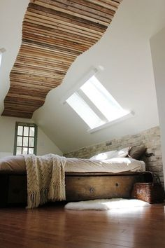Eclectic Guest Bedroom with Skylight, Reclaimed barnwood platform bed, Hardwood floors, Sheepskin Rug Single Pelt White Fur
