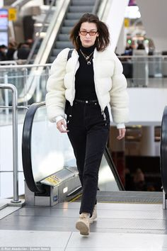 Monochrome magic!Bella Hadid was back in the United States on Thursday after a whirlwind few days walking the runway in the fashion capital