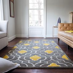 The striking Logan Rug sets the new standard for boldly patterned rugs. Hand-tufted in India of 100-percent wool, this rug is crafted with a cut and loop pile blend to create visual interest. Logan is an eye-catching design that will fit any home d�cor.
