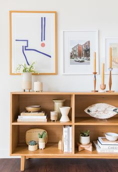 A perfectly styled bookshelf complete with the pottery collection of our dreams. Styled by @mjburstin