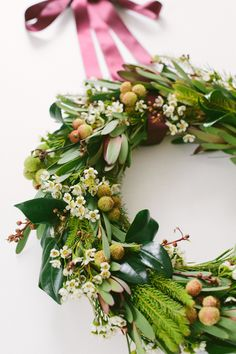Australian Christmas wreath of white waxflower, pinky-yellow berzelia, leucadendron and other foliages and greenery