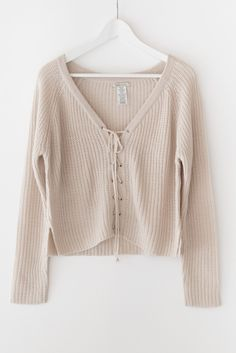 "- Nude oversized front lace-up sweater - Chunky sweater knit material - Slightly cropped fit - Size S/M has a total length of approx. 21"" - 100% Acrylic - Imported"