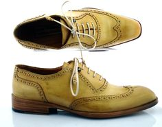Hand made full brogue oxfords. Mustard upper composed of calfskin leather. Blake construction. Leather wrapped laces. Antique finished leather sole. Each pair will have a unique colour and contour as they are hand craftedfor the customer.Since this is a made-to-order product, please allow up to 15 working days for delivery.