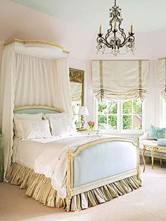 Lovely bedroom with a light teal upholstered bed. #Frenchbedroom Fresh and feminine.