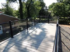 Ornamental aluminum glass railing on top of composite deck atop a roof