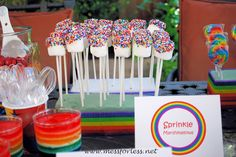 """These were super easy to make and a big favorite with the kids. Get some lollipop sticks and place a marshmallow on top. Dip the top part of the marshmallow in water and roll in sprinkles. Display in some stryofoam. Thats it, youre done!"""