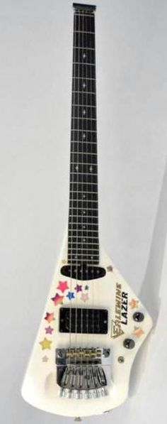 Custom Erlewine Lazer (Apparently this was Johnny Winters favorite Guitar in later years as it was much lighter than his Gibsons) --- https://www.pinterest.com/lardyfatboy/