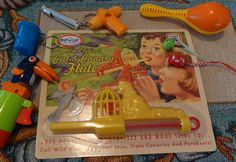 Cat and Canary slide whistle - love it, the canary bounces up and down interupting the air flow . . . totally unique sound. Surrounded by some of my other toy store finds.
