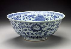 Large Bowl (Wan) with Lotuses and Floral Scrolls China, Jiangxi Province, Jingdezhen, Chinese, middle Ming dynasty, about 1450-1550 Furnishings; Serviceware Wheel-thrown porcelain with underglaze blue painted decoration, and clear glaze Height: 5 1/8 in. (13 cm); Diameter: 12 7/8 in. (32.7 cm) The Nasli M. Heeramaneck Collection, gift of Joan Palevsky (M.73.5.351) Chinese Art