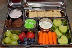 Yogurt, LeClerc probiotic cookies, grapes, blueberries, strawberries, carrots, heart-cut cucumber, dip, wheat thins