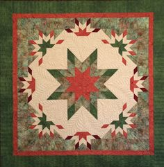 "Pam Goggans' new pattern Supernova is a real star! The center contains a large Blazing Lemoyne surrounded by a frame of smaller Blazing units. This wall-sized project finishes to 46"" square. You can purchase it on www.SagerCreekQuilts.com."