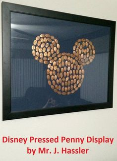This Disney Pressed Penny display was created by Mr. J. Hassler - The trick is to go to a coin dealer and buy rolls of pennies from before 82 when they were still all copper.... they press the best. This one is about 200 pennies. Just use a strong craft clue to hold them in place on a piece of colored foam core. This frame is 22x28
