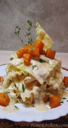 This topless butternut ravioli should be the poster board child for autumn comfort food that will satisfy all of your cravings. It has a creamy wild mushroom sauce with herbs, savory sautéed chicken, naturally sweet roasted butternut squash, cheesy gouda and even has a crispy fried ravioli toppings.