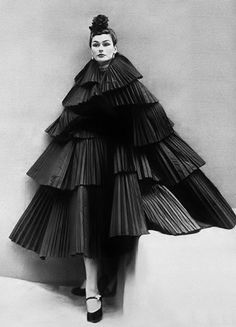 Because who wouldn't want a dress made out of old tires in the shape of a Christmas tree?