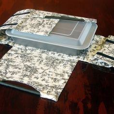 Casserole Carrier.  I have one from this site and it's the best design I've ever used.  I just got her PDF pattern to make more.
